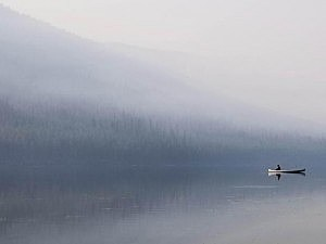Canoe on Logging Lake 9-4-17. It would be a beautiful photo is that was an early morning fog instead of smoke from the Adair Peak fire. (NPS Photo)